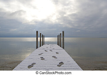 Dock, Footprints, Breaking Sun - Sun breaking through clouds...