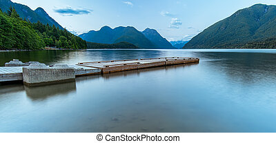 Dock on Lake Surrounded by Mountains