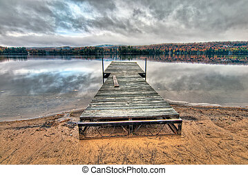 Dock On Lake With Dramatic Sky Reflection