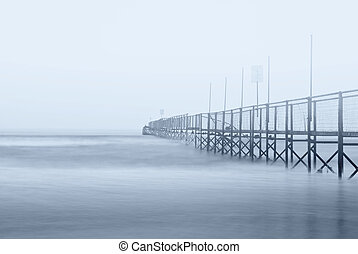 dock shrouded by the fog