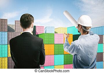 Dock worker explaining to businessman