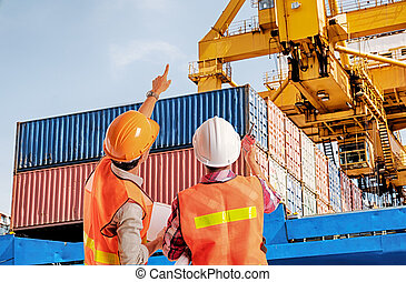 Dock worker pointing finger on control of container loading in an industrial harbor