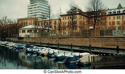 Docked and covered for winter season motor boats on the...