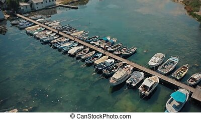 Docked boats at summer day - Top view of yachts from flying...