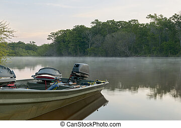 Docked river fishing boat and crisp sunrise mist