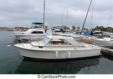 docked sail boats - Sailing boats docked in marina under...