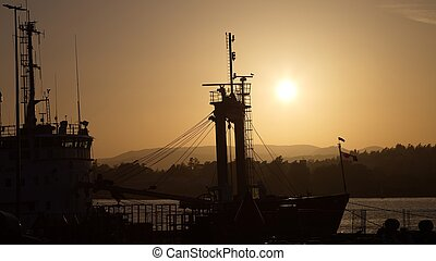 Docked ship at sunset