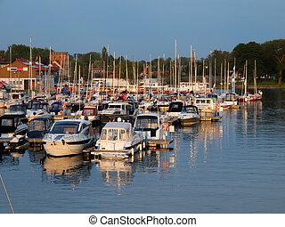 Docked yachts in a marina