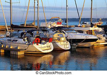 Docked Yachts - Serene scene of a marina with docked yachts...