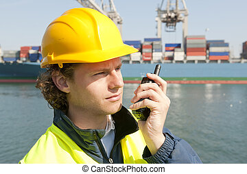 Docker on the radio - Harbor worker, listening to his radio...