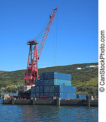 Crane and containers in shipyard
