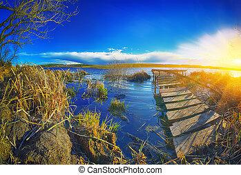 docks on the lake at sunset