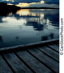 Sitting on a dock at sunset on a northern lake in western Canada.