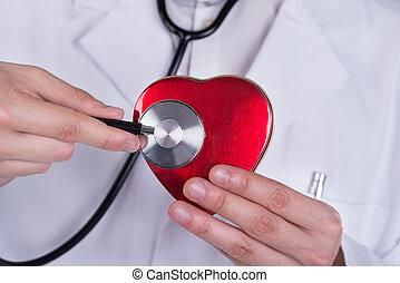 docteur, examiner, forme coeur, à, stéthoscope