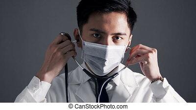 docteur, monde médical, asiatique, jeune, stéthoscope, blanc, usures, tenant manteau