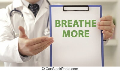 Doctor advice patient to breathe more - Doctor wearing a...