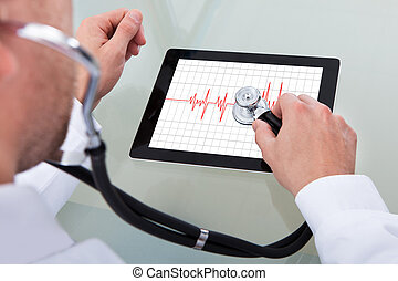 Doctor Analyzing Heartbeat On Digital Tablet