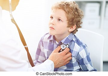 Doctor and child patient. Physician examines little boy by stethoscope. Medicine and children's therapy concept