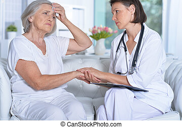 doctor and her  senior patient