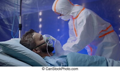 Doctor and infected patient in hospital, coronavirus concept.