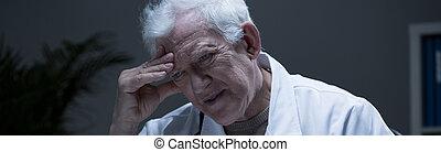 Doctor and mental disease - Older lonely depressed doctor...