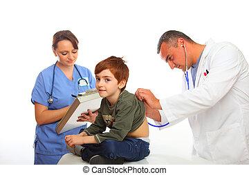Doctor and Nurse examining a boy