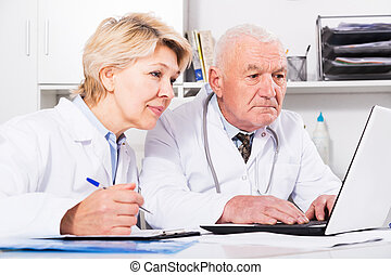 Doctor and nurse in office