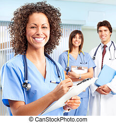 doctor and nurses - Smiling medical people with stethoscopes...
