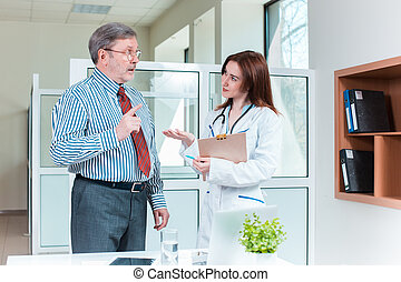 Doctor and patient at the medical office