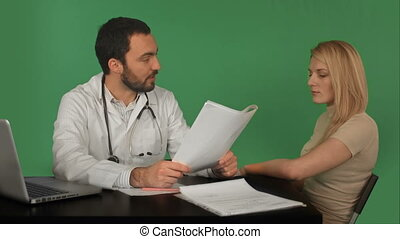Doctor and patient discussing - visit in the office on a Green Screen, Chroma Key
