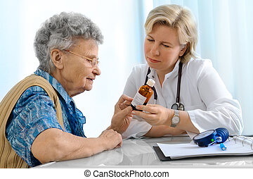 doctor and patient - elderly patient by a doctor