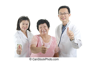 doctor and patient giving thumbs up