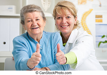 Doctor and patient - Happy senior patient and doctor at the ...