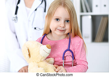 Doctor and patient in hospital. Child being examined by physician with stethoscope