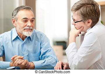 Doctor and patient - Male patient tells the doctor about his...