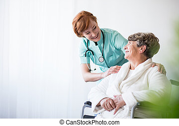 Doctor and patient on wheelchair