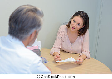 doctor and patient sitting by the table