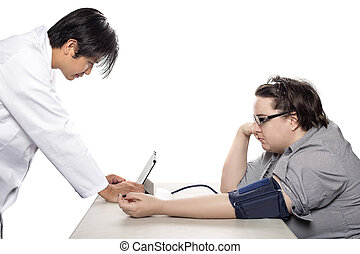 Doctor and Patient with Electronic Blood Pressure Monitor