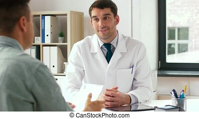doctor and patient with prescription at clinic - medicine,...