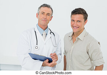 Doctor and patient with reports in medical office