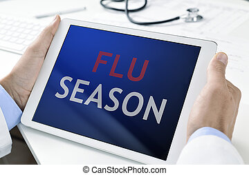 doctor and tablet with the text flu season