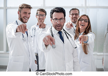doctor and the hospital staff are pointing at you.
