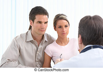 doctor and young couple - Medical doctor and young couple...