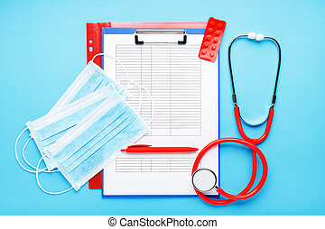 Doctor appointment. Red stethoscope, Medical hygienic masks, tablets, medical documents on doctors workplace in clinic. Concept medicine health care, research, science, virosology. Coronovirus Covid-19