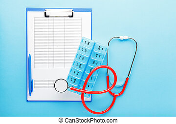 Doctor appointment. Stethoscope, pill box, medical documents on doctors workplace in clinic long blue banner. Concept medicine health care, research, science. Coronovirus Covid-19 test analysis form
