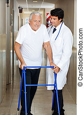 Doctor Assisting Old Man On a Walker