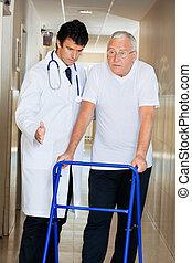 Doctor Assisting Senior Man On a Walker