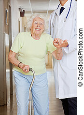Doctor Assisting Senior Woman
