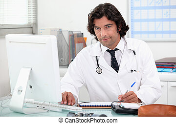 Doctor at a computer