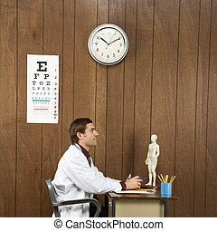 Doctor at desk.